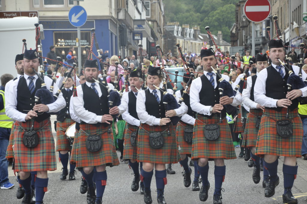 Pipers led the parade through the bustling town centre.