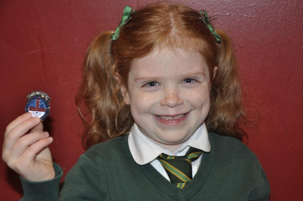 Mollie MacKenzie, 7, from St Columbas Primary School  won a silver medal forher age group reciting Mucan, beaga, beaga - Little piggy piggy.