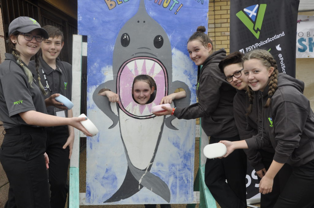 Police Scotland Youth Volunteers were handy at the shark attack stand raising funds for a skatepark.