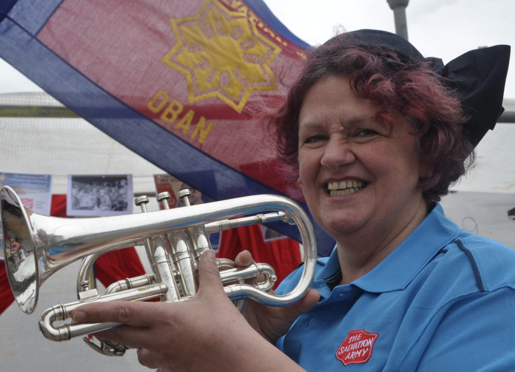 Jeanette Sheldrick blows the trumpet for Oban Salvation Army.