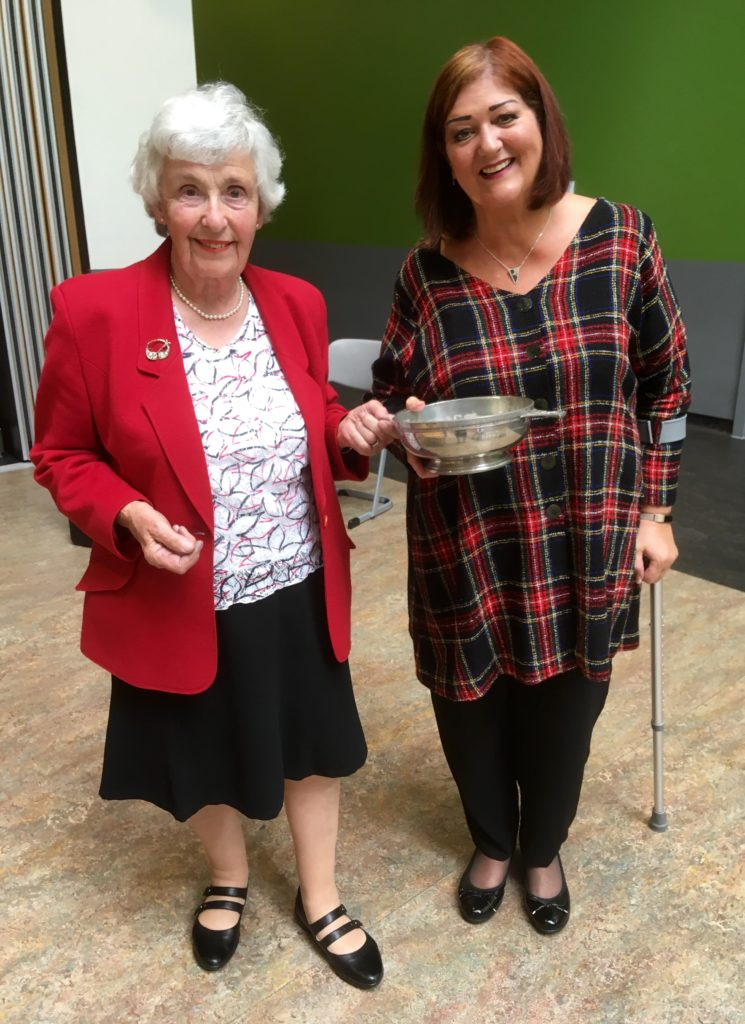 Taynuilt Gaelic Choir's conductor Audrey Paterson receiving the Hugh MacPherson Memorial Quaich from Ishbel Banks.