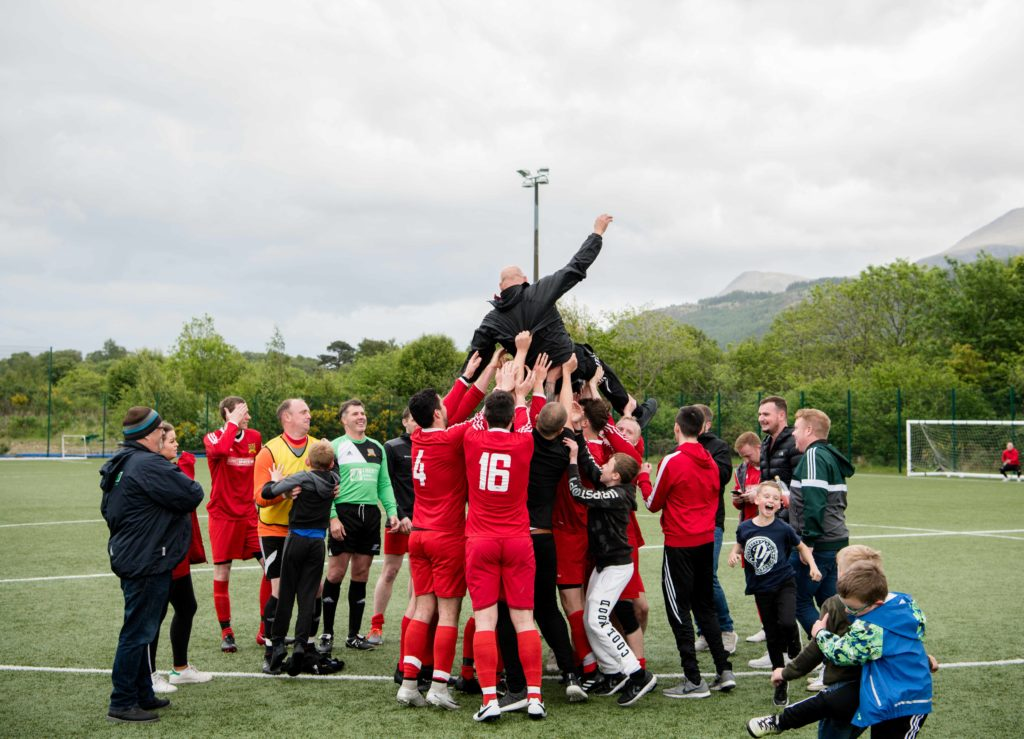 Manager Alan Gray is hoisted in the air by the players. Photograph: Abrightside Photography.NO F23 SLT title win 03