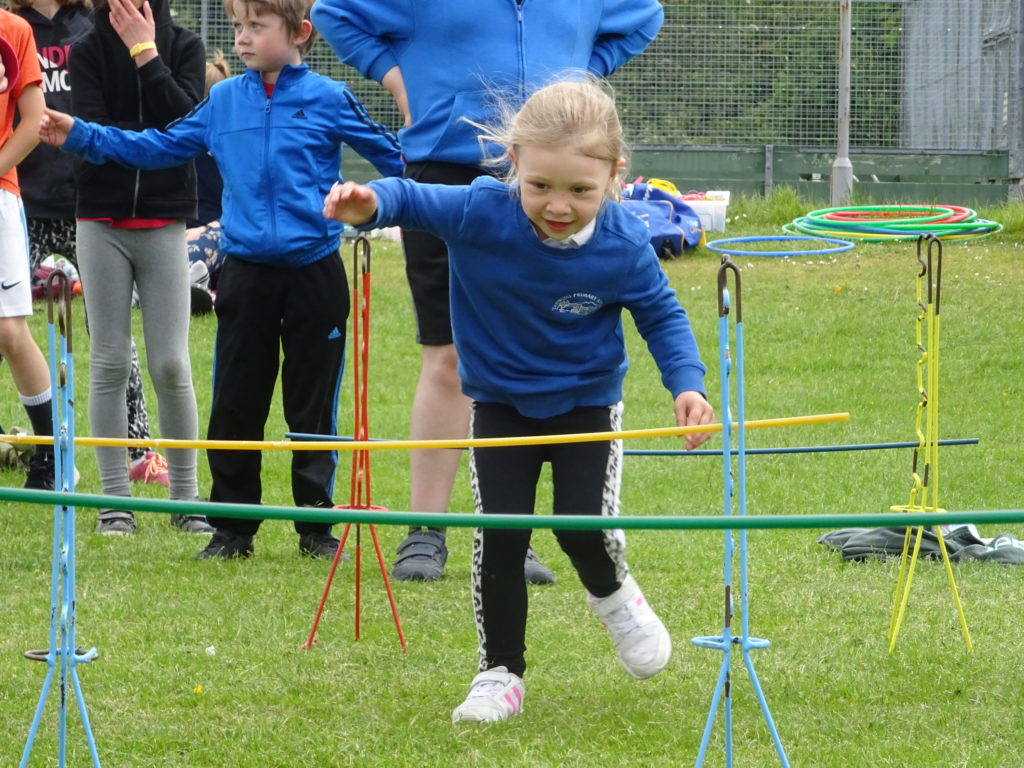 This girl keeps her eye on the prize as she navigates one of the obstacles.