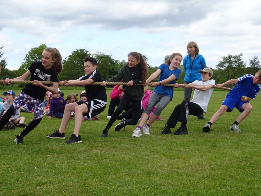 Determined pupils strand strong in the tug-of-war race.