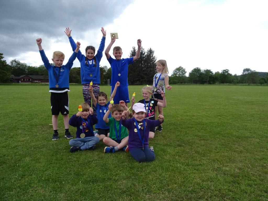 Winners show off their medals and ice lollies.