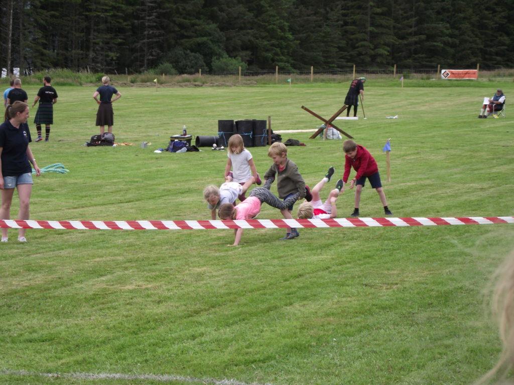 Fun at the wheelbarrow race.  NO F29 wheelbarrow