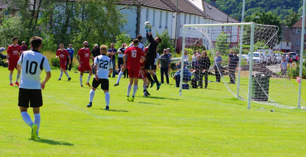 Saints keeper Ben Pollock collects this cross in the game against Dundee United.