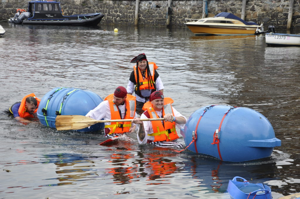 The first half of Oban Bay Pirates after finishing the race. 15_T35_RaftRace11