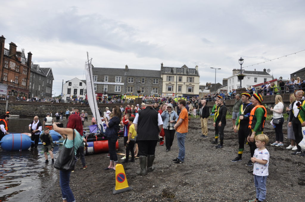 Competitors and spectators watch as the rest of the fleet row in. 15_T35_RaftRace17