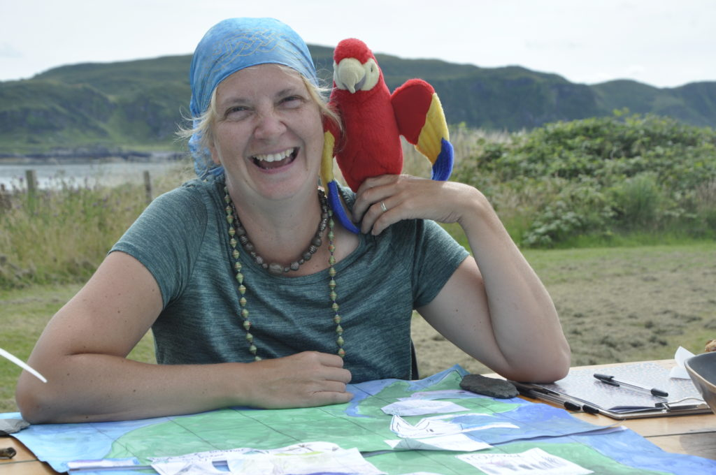 Pirate Rachel Smith helps raise treasure for Seil Island Hall  on Easdale Primary School's stall.
