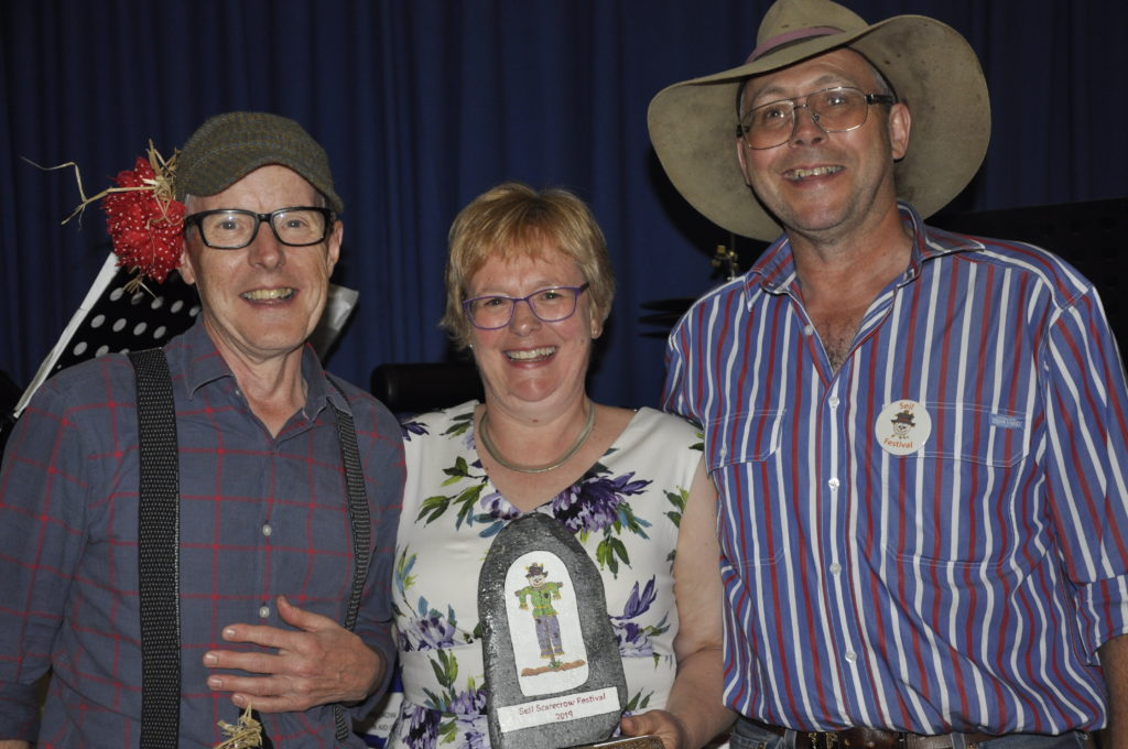 George MacKenzie presents the best scarecrow trophy to Avril and Seumas Anderson from Kilbride Farm.
