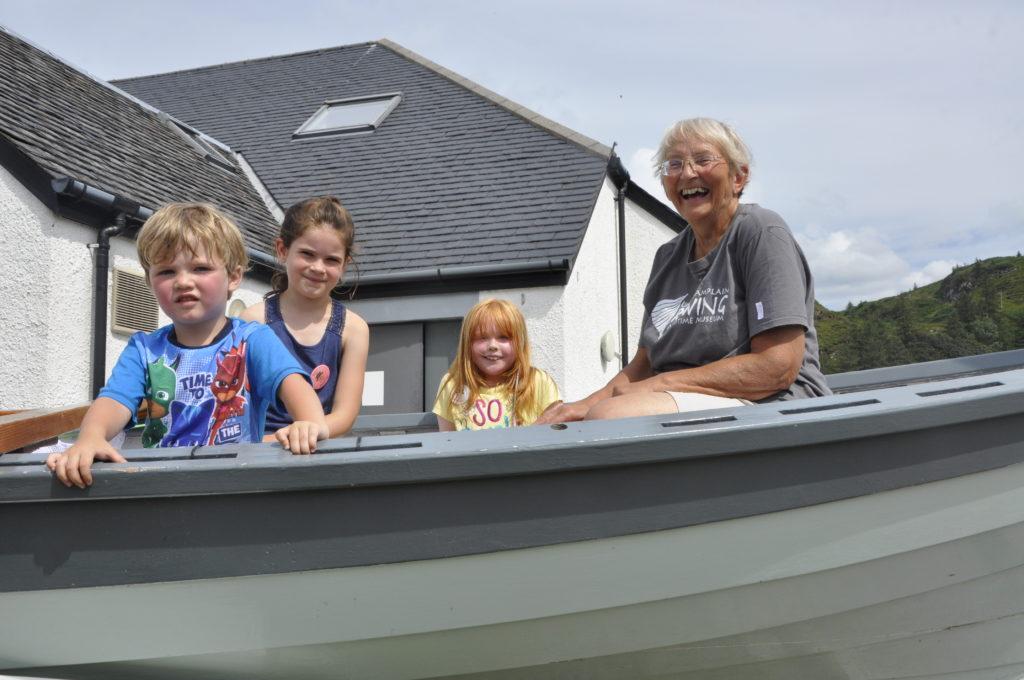 Sue Fenton in the Seil skiff with Eve Pawson, Orla Scudder and Ruach Smith.