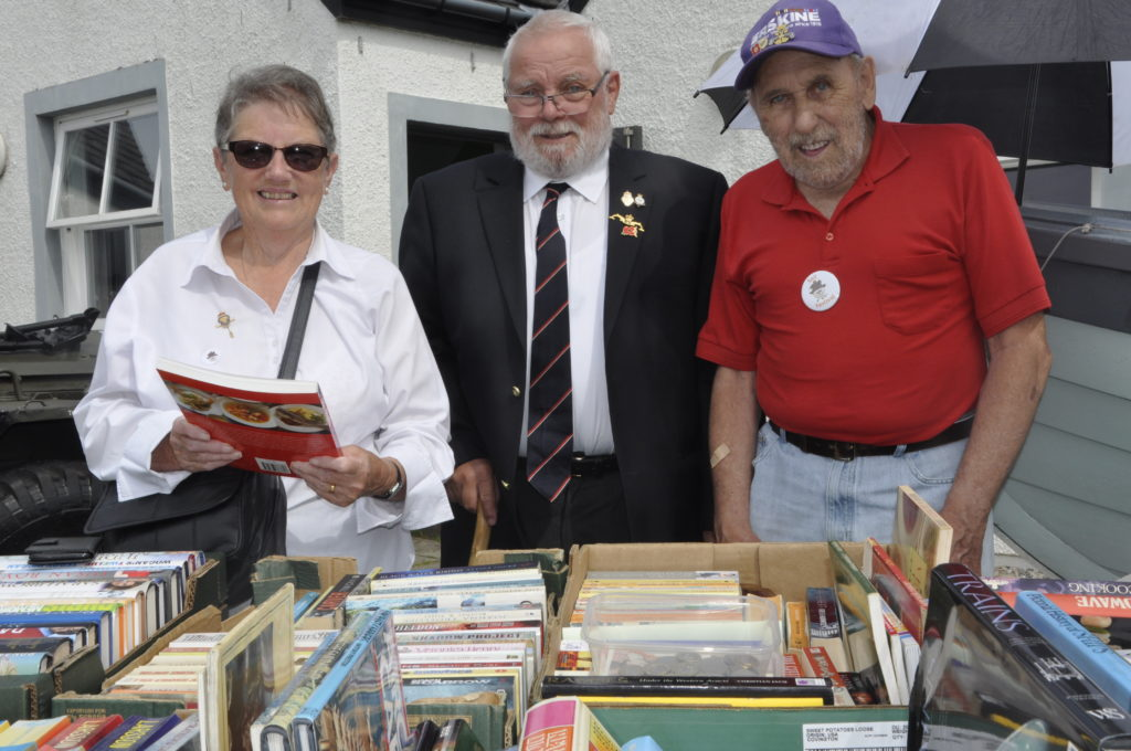 Jean and John Alexander with Kneale Smith of the Easdale branch of the Royal British Legion ran a book stall at Seil's recent Scarecrow Festival.