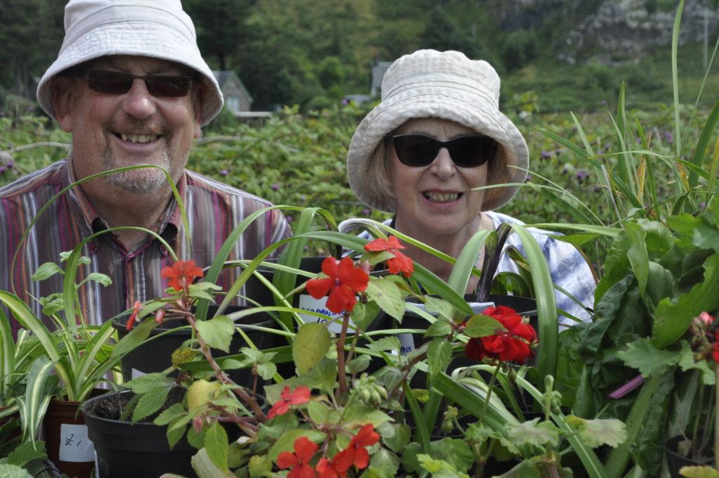 Myra and Martin Waddle on Kilbrandon Church's plant stall.