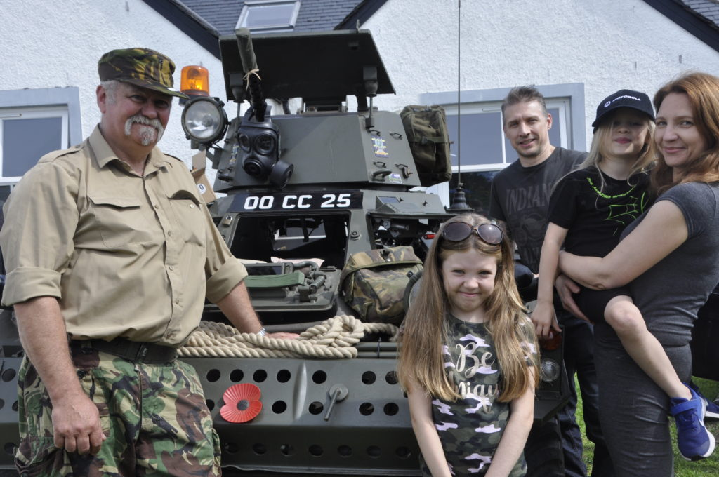 Hugh MacNeil with his Daimler Ferret Scout car and visitors Paul, Vivienne, Isabella and Elena Harding.