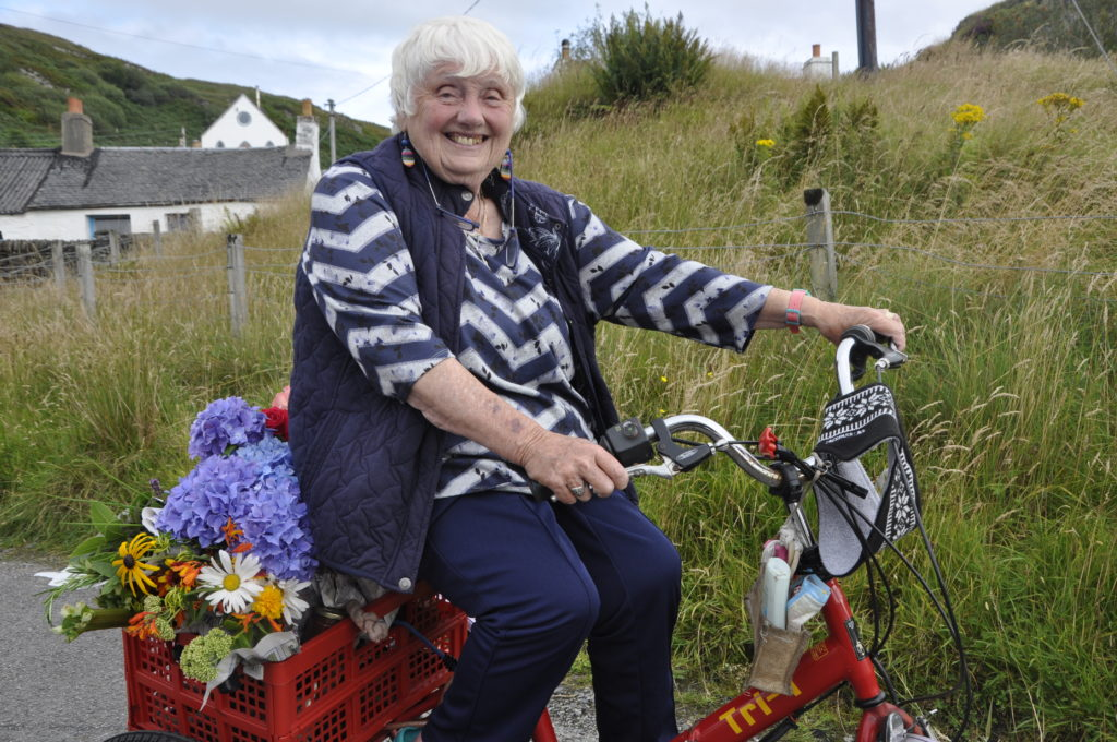 Jacqueline McDonald needed her trusty trike to take home all her successful bids from the auction.