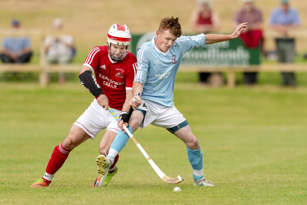 Finlay Macrae, Kinlochshiel and Caberfeidh's Ryan Mackay battle for the ball during last weekend's Mowi Premiership match played at Kinlochshiel's new pitch at Reraig, Balmacara. Photo: Neil Paterson.