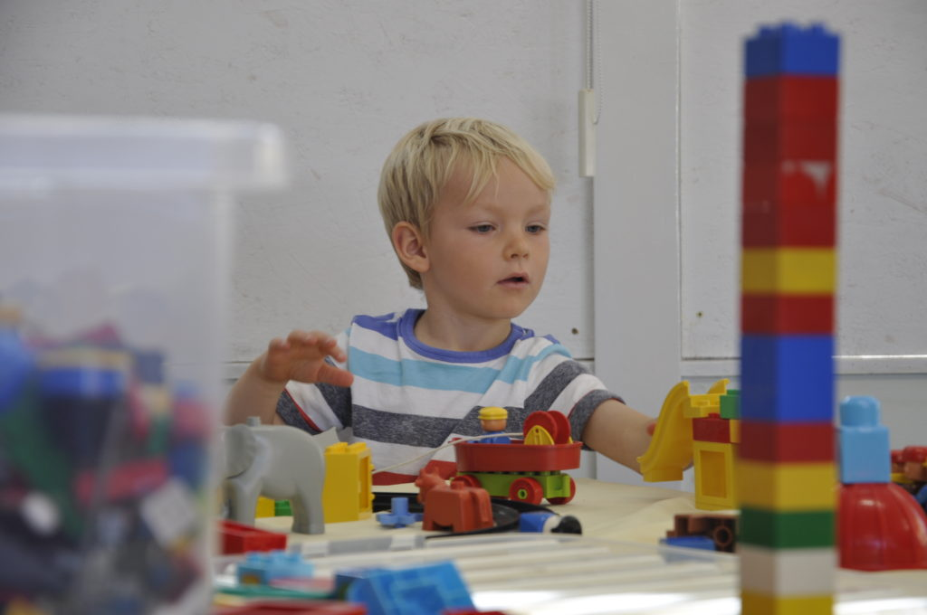 Magnus Stewart, four, was busy building out of Lego. 15_T39_StoneFest05