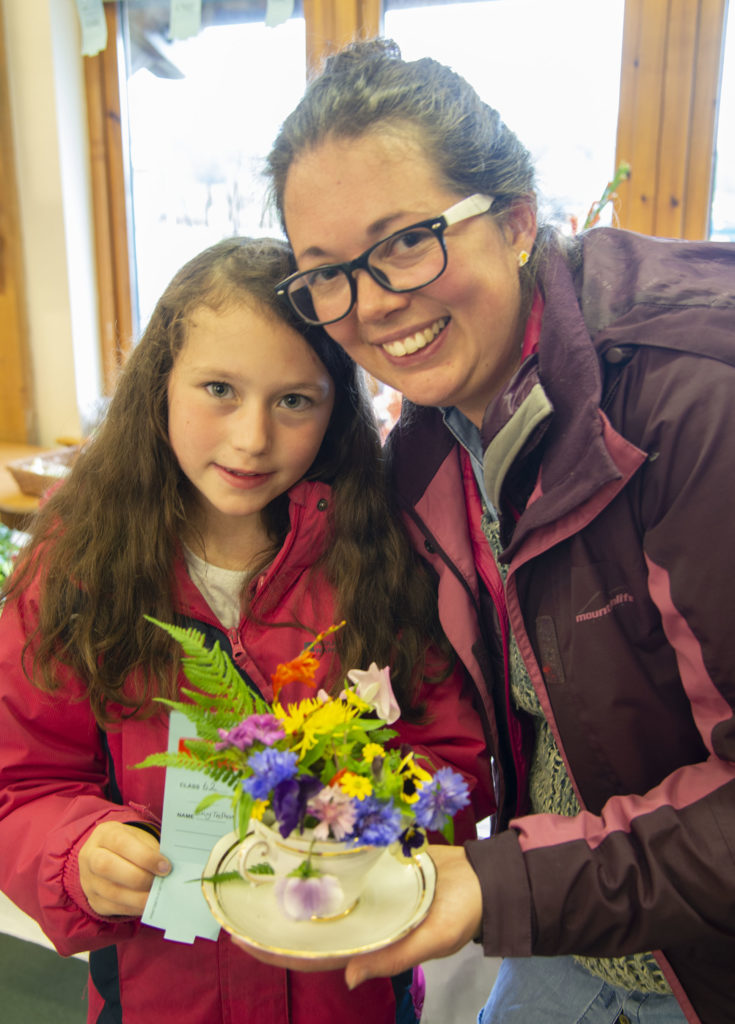 Winner of  the 'Arrangement in a Teacup' Lucy Tedham with her daughter, Pippa. Photo: Iain Ferguson, alba.photos. NO F37 Rural complex garden 02