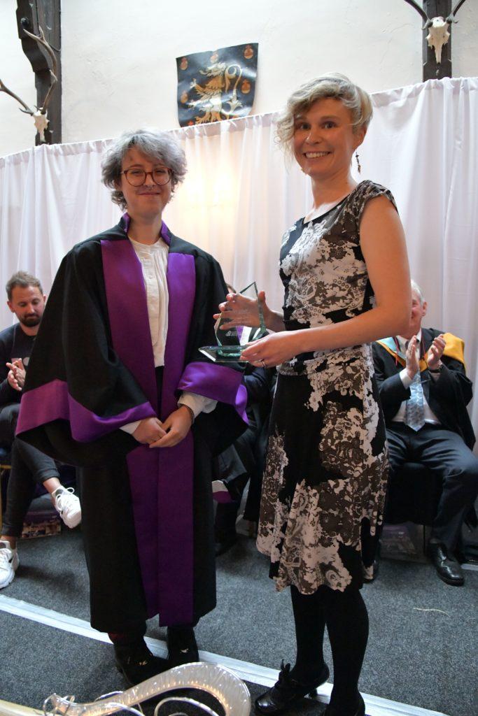 Rachael Hathaway receives HIS Award for Most Inspiring VC Tutor from HISA vice president Natasha Morgan.