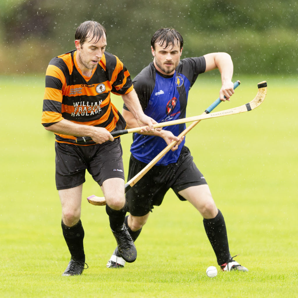 In one of only four matches to beat the weather Boleskine took on Lewis Camanachd. Our photograph shows Boleskine's Rory Campbell and Paddy Sinclair, Lewis Camanachd, in a race for the ball. Photograph: Neil Paterson