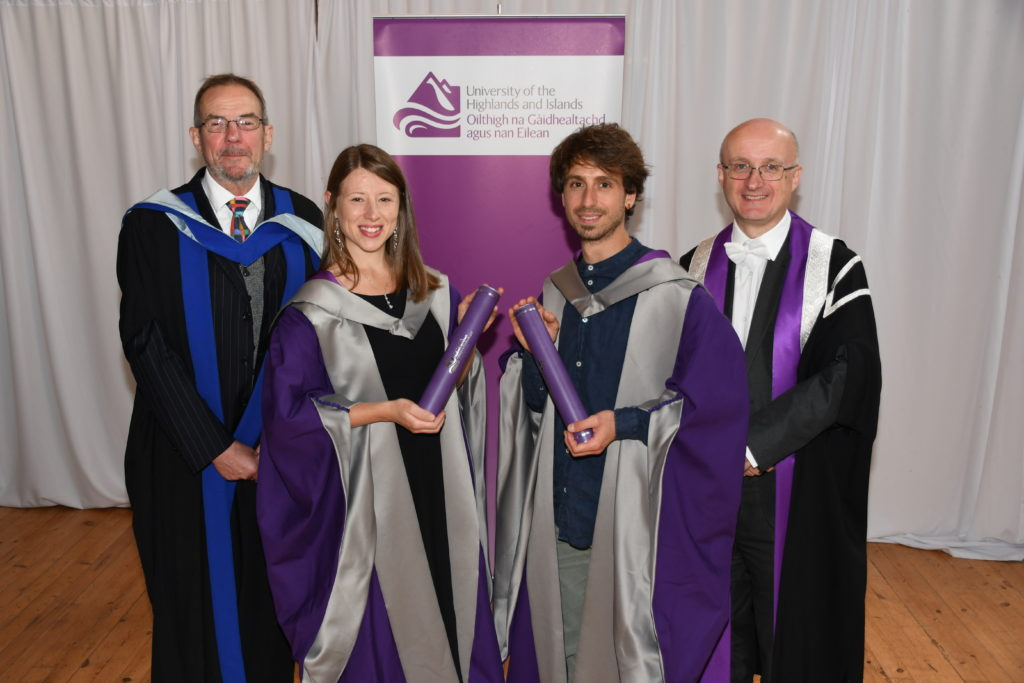 The first two PhD graduates from the University of the Highlands and Islands, Dr Winnie Courtene-Jones and Dr Andrea Garvetto are congratulated by SAMS UHI director Prof Nicholas Owens and vice-principal Prof Neil Simco.