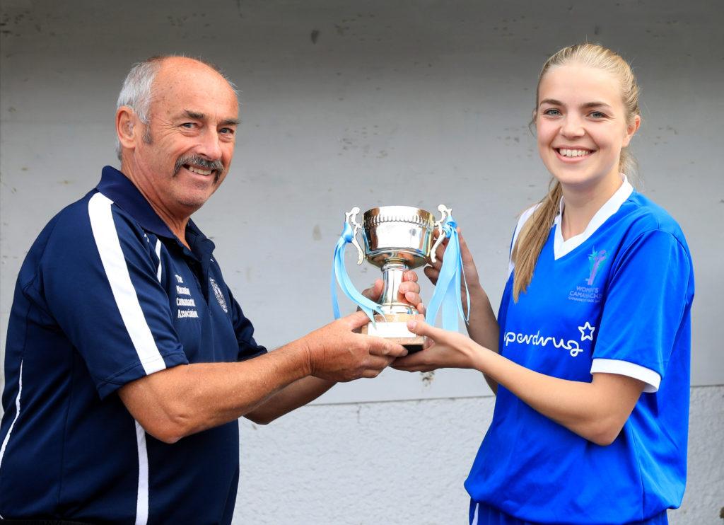 Blue Area senior team captain Rhona McIntyre receives the trophy from the Macaulay Association's David Hamilton.