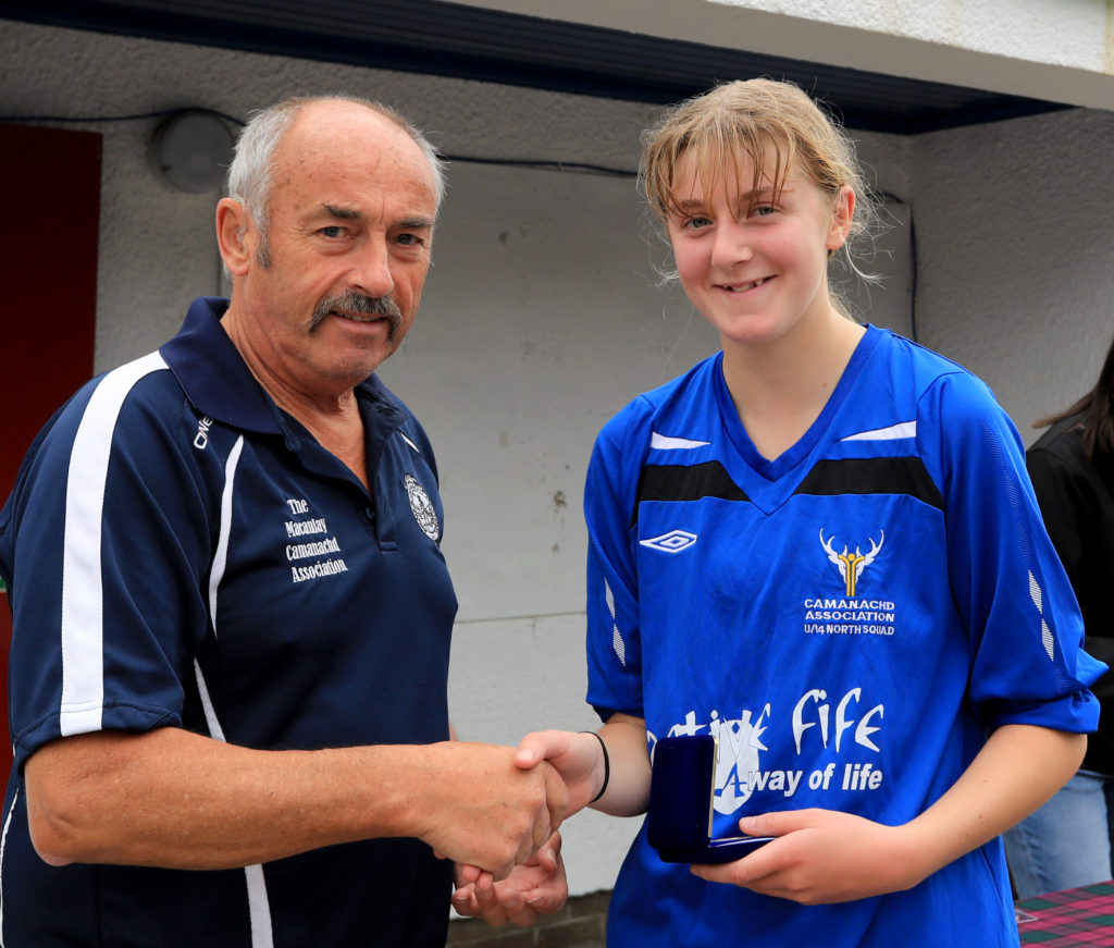 Under 14's player of the match Katie Slimon is presented with her award by David Hamilton.
