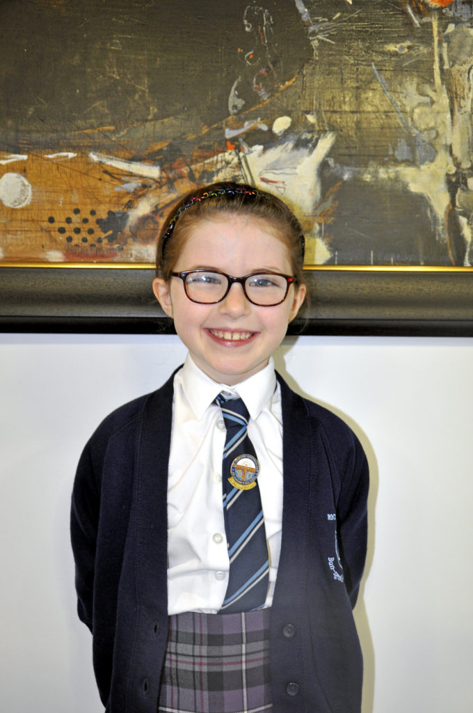 Seven-year-old Lucie Spreadbury, of Oban's Bun-sgoil Achadh na Creige, won the poetry gold medal for girls aged 7-8  learners, reading 'Mucan beaga beaga': 'A Wee Pig'. She may be getting used to winning, having taken a gold in the mod in Oban and a silver on Mull, but her mum Hazel Kelso still 'almost cried' with pride. Four of Lucie's sisters are competing throughout the week. 15_SN_ModMon_04