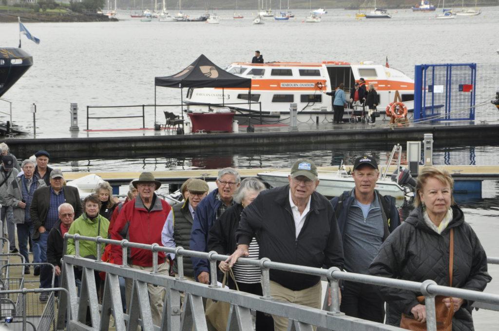 Passengers make their way ashore.