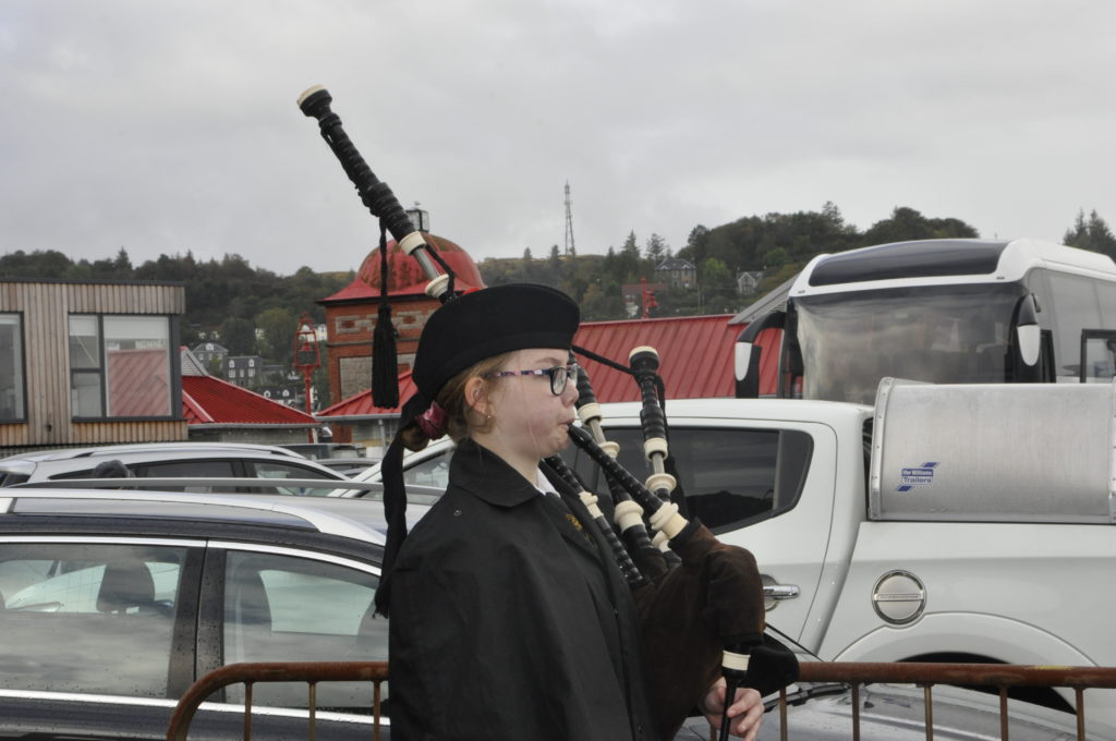 Emma Hill, Oban High School Pipe Band, pipes in the last cruise ship passengers of the season.