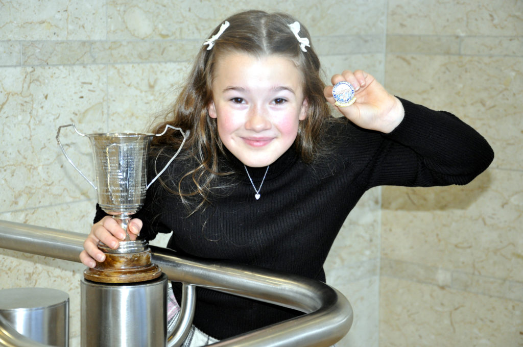 Feorlin Renton, 10, from Inveraray, took home the Mrs Roderick B Munro trophy after winning the girls 9-10 solo singing learners competition. 17_DM_ModMonday06