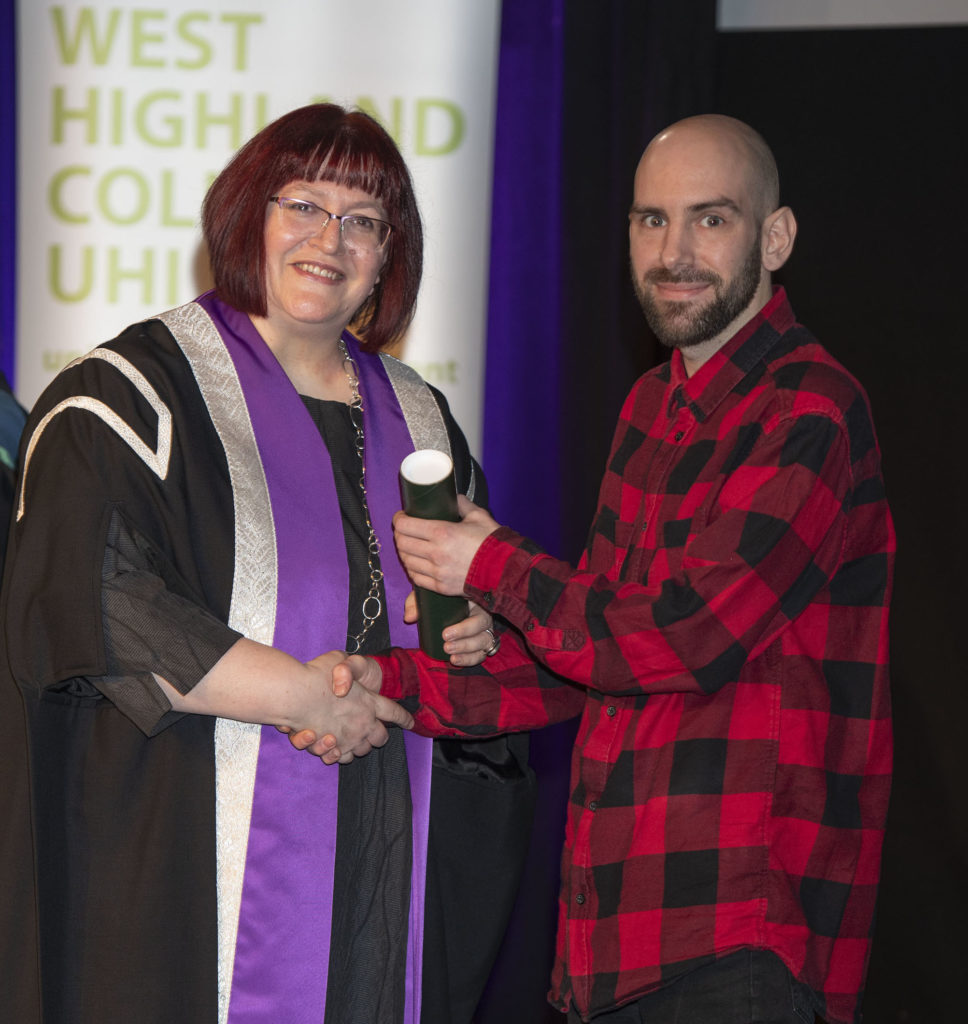 Lydia Rhomer presents Stephen Hardie with theCalMac award for student making the most progress. Photograph: Iain Ferguson, alba.photos  NO F42 WHC FE STEPHEN HARDIE