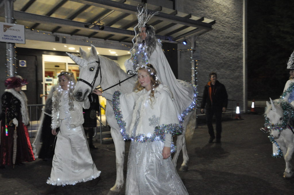 Winter Queen, Eilidh Betts, sets off on her soujorn around the town on Aoife the unicorn.