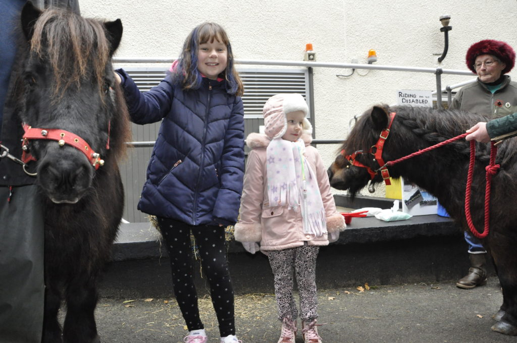 Rebecca Fitzsimmons and Mia Hodge make friends with Bobby and Charlie the Shetland ponies.