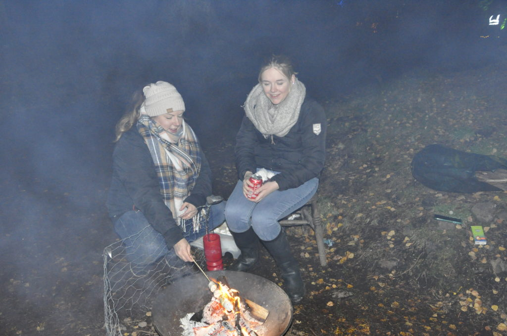 Toasting marshmallows in the Winter Woods.