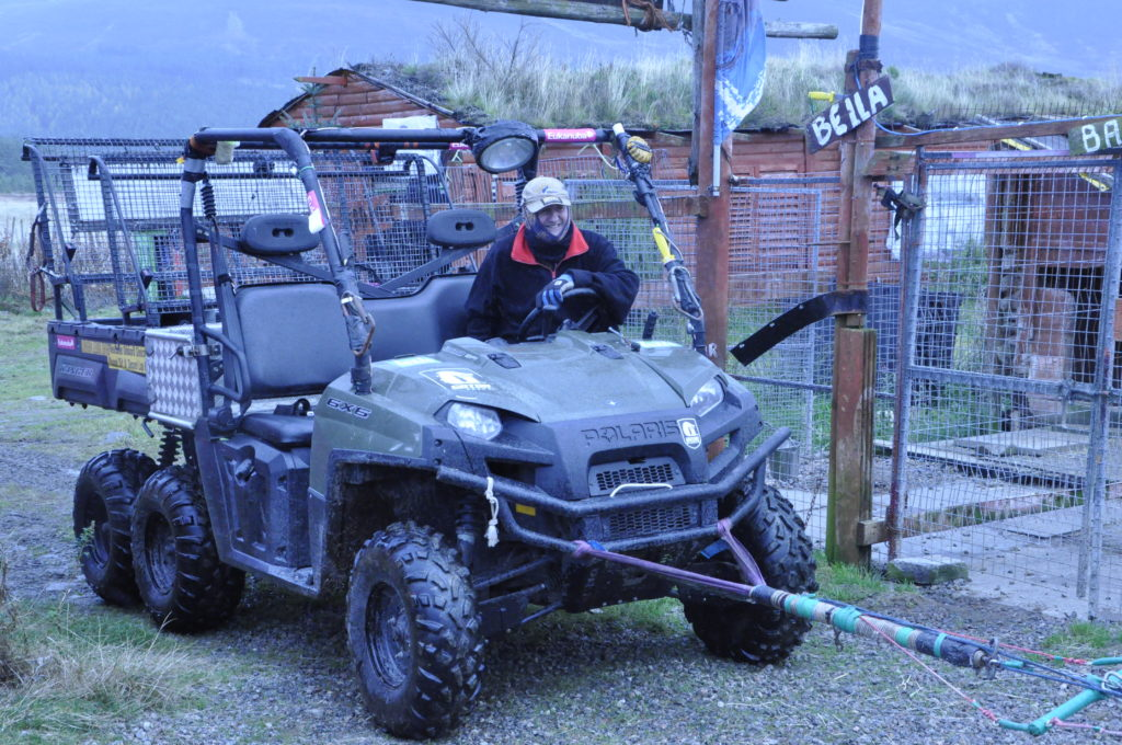 Alan uses his 6x6 side by side offroad ATV and 12 dogs for training sessions.