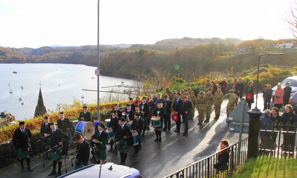 Tobermory High School Pipe Band and the Mull Army Cadet Force prepare to march to the Tobermory War Memorial on Remembrance Sunday 2019. Photograph: Stephanie Cope