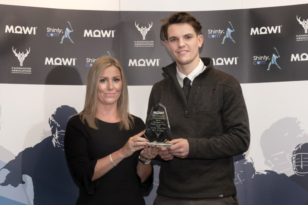 Mowi's Jayne Mackay presents the National Div. player of the year award to Fort William's Arran MacPhee. Mowi Shinty Awards Luncheon and Conference at The Kingsmills Hotel, Inverness.