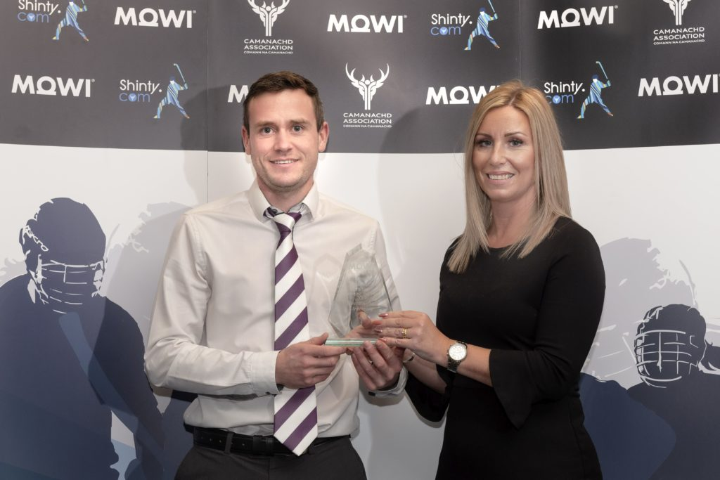 Mowi's Jayne Mackay presents the North Div 2 player of the year award to Strathspey's Bruce Grant. Mowi Shinty Awards Luncheon and Conference at The Kingsmills Hotel, Inverness.