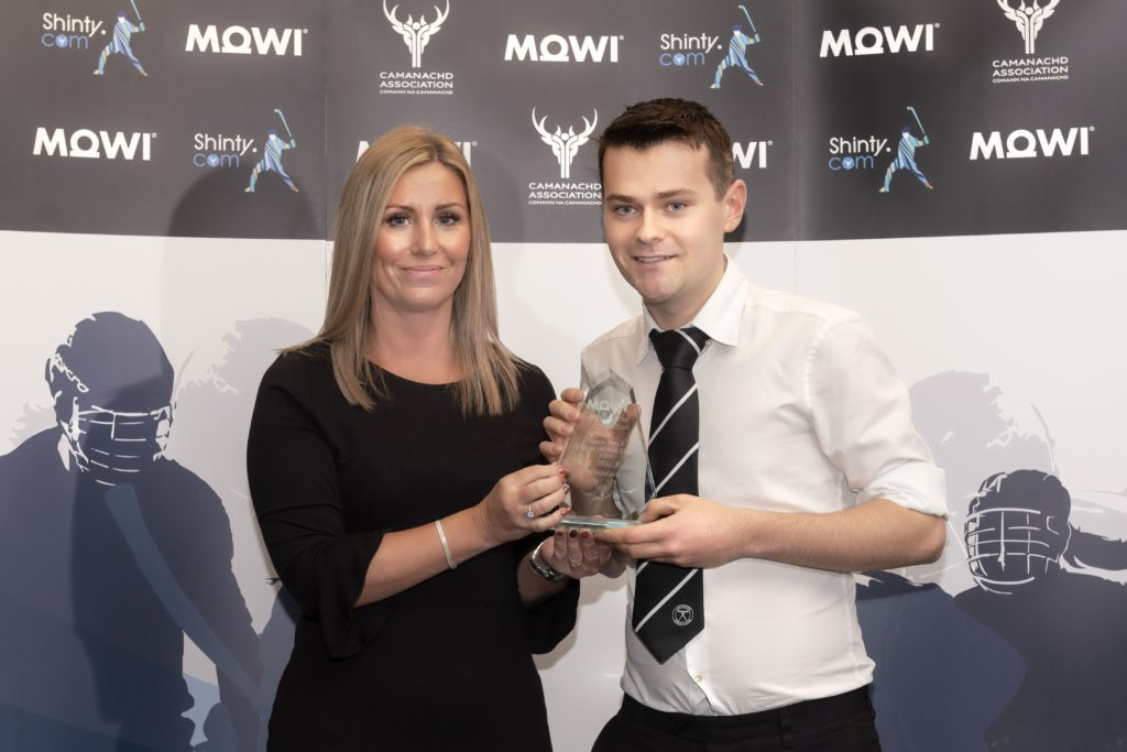 Mowi's Jayne Mackay presents the South Div 1 player of the year award to Aberdour's David Mackenzie.  Mowi Shinty Awards Luncheon and Conference at The Kingsmills Hotel, Inverness.