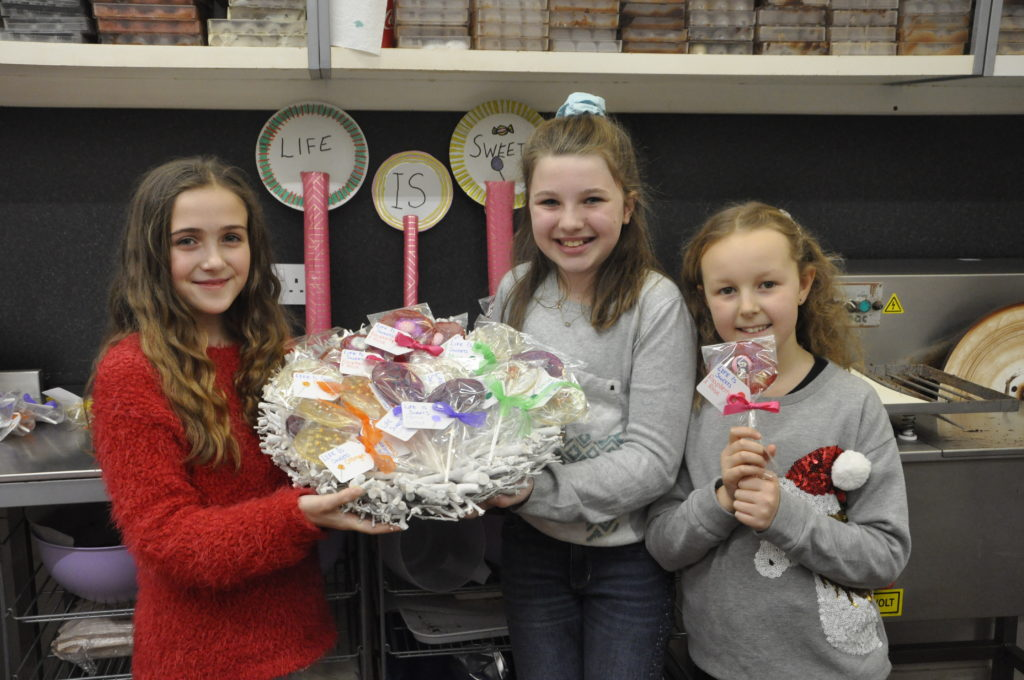 Abbi Ferguson, Aimee Greenlaw, and Ella Mackechnie produced over 50 flavoured lollypops for the Junior Entrepreneurs Market on Saturday.