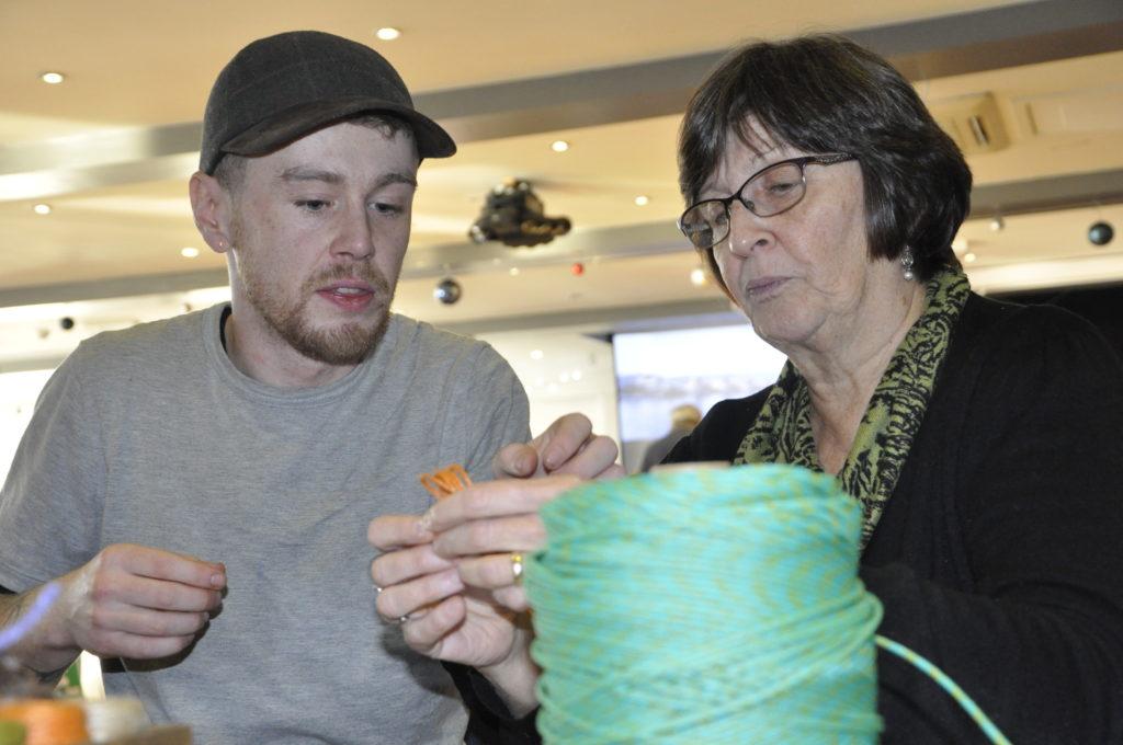 Sean Chilton from the Scottish Fisheries Museum guides Karen Mackie through some nautical knot making.