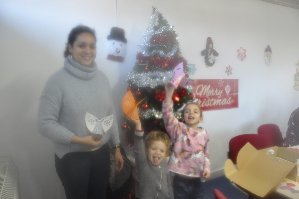 Iriammi Mumoz joined her son Eilean and daughter Joyce in making festive angels at Create and Make it for Christmas at the Rockfield Centre.