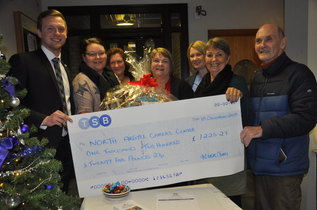 The TSB hands over its cheque to North Argyll Carers Centre.