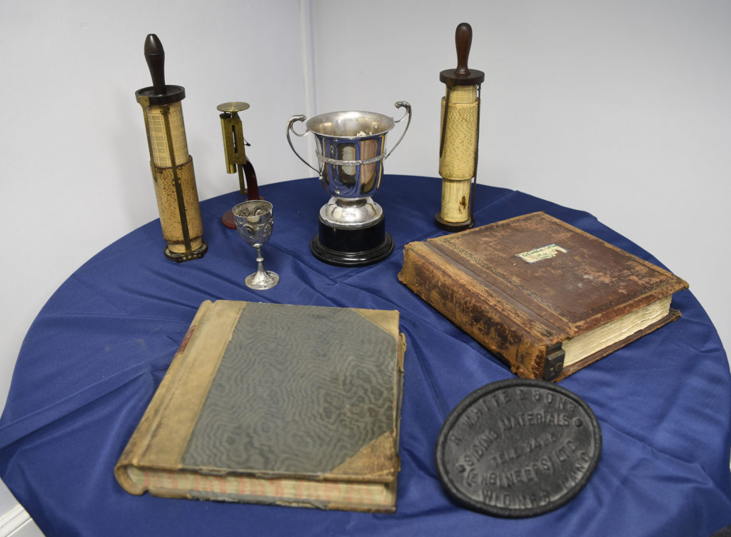 Ledgers and trophies from the plant's history. Photograph:  Iain Ferguson, alba,photos  NO F01 LIBERTY EXHIBITION 03