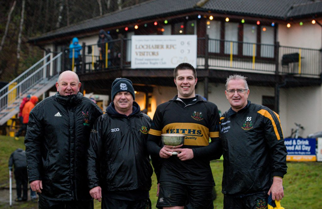 Lochaber's victorious captain, Callum MacDonald, with from left, the coaching team of Ali MacKinnon, Gary Hendrie and Stewart Sandison.  NO F50 LRFC win bowl