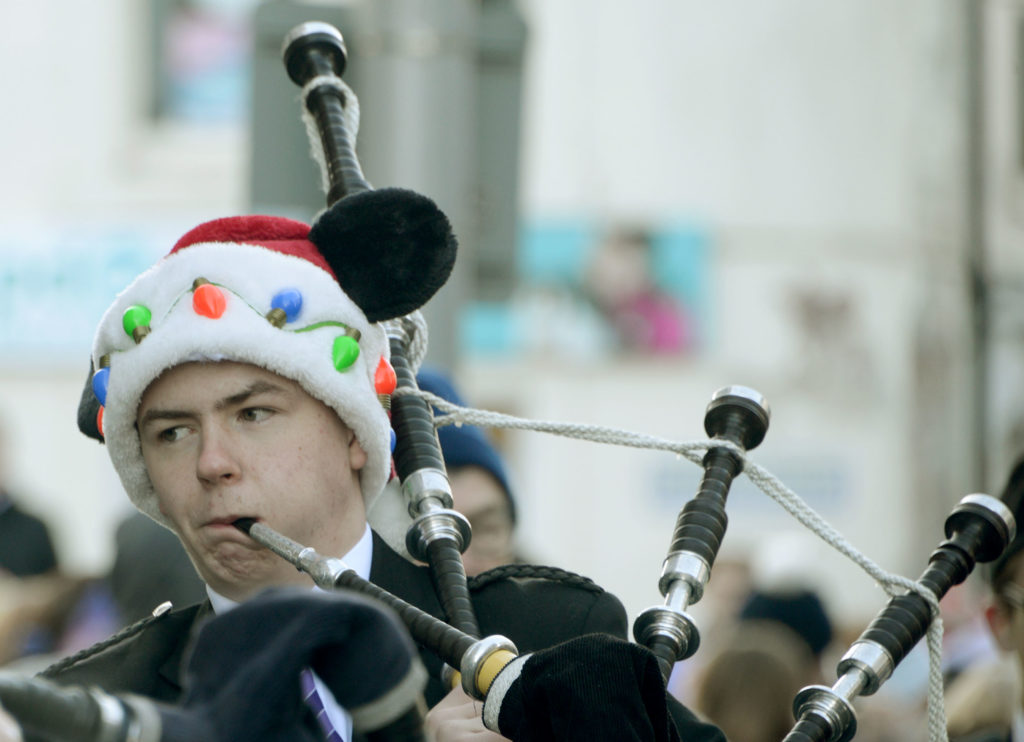 Piper Ronnie Macintosh  gets into the Christmas spirit. Photograph: Iain Ferguson, alba.photos