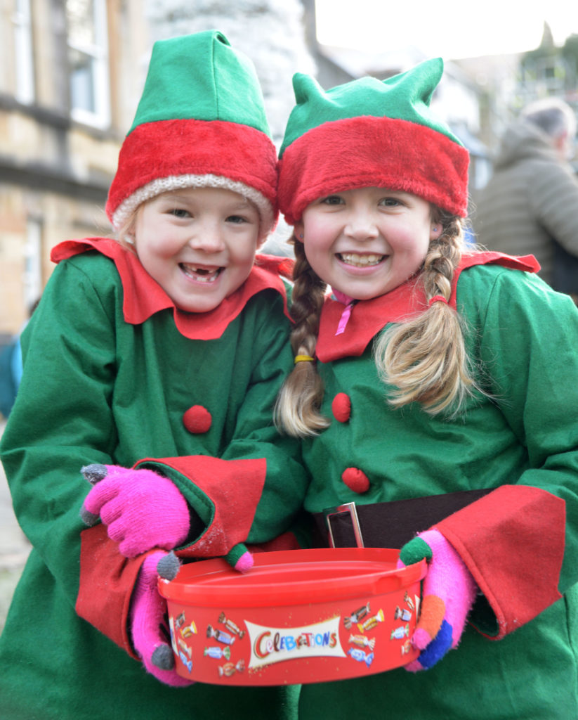 Prize winning elves Phoebe MacDonald (left) and Poppy Geddes brought Christmas cheer to crowds in Cameron Square waiting for the Santa processions to start.  Photograph: Iain Ferguson, alba.photos