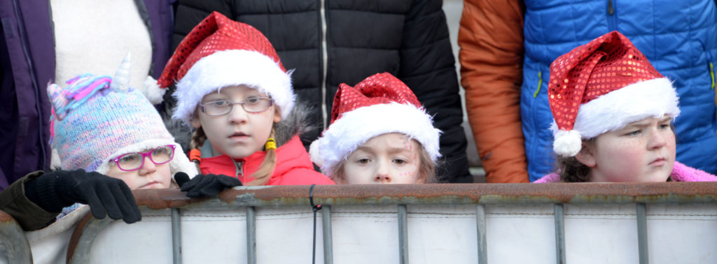 These little 'Santas' were only just big enough to peer over the barriers and see the reindeer in Cameron Square. Photograph: Iain Ferguson, alba.photos